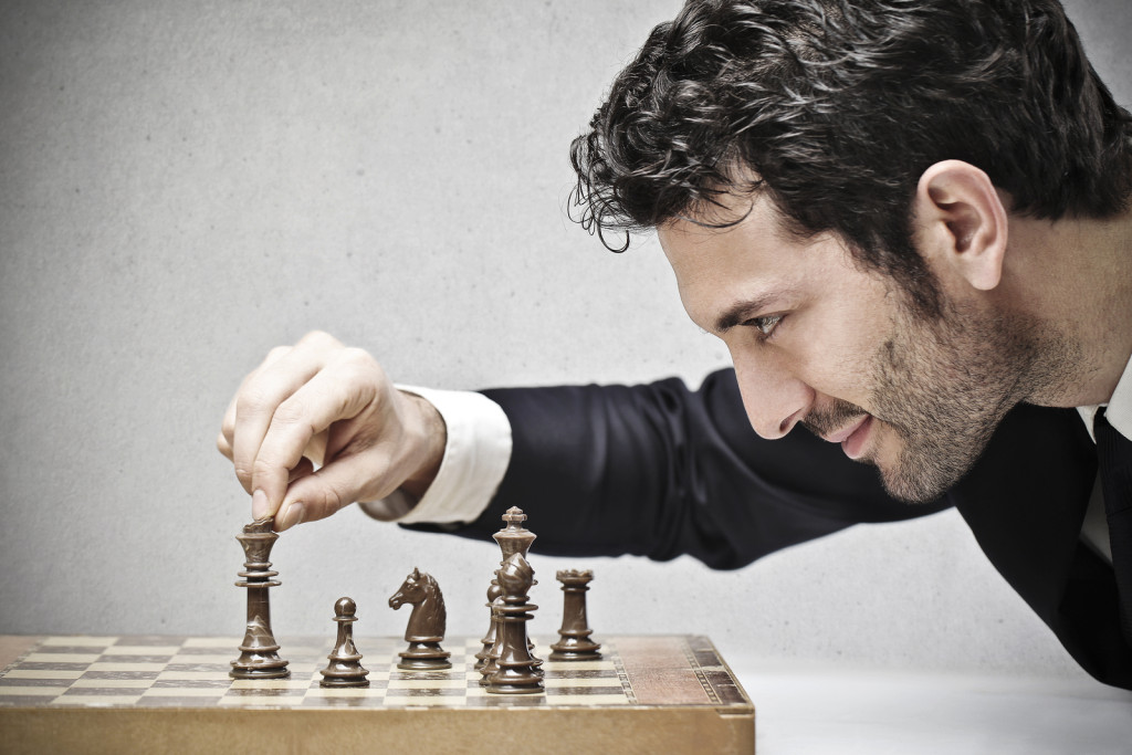 bigstock-young-business-man-playing-che-42100858